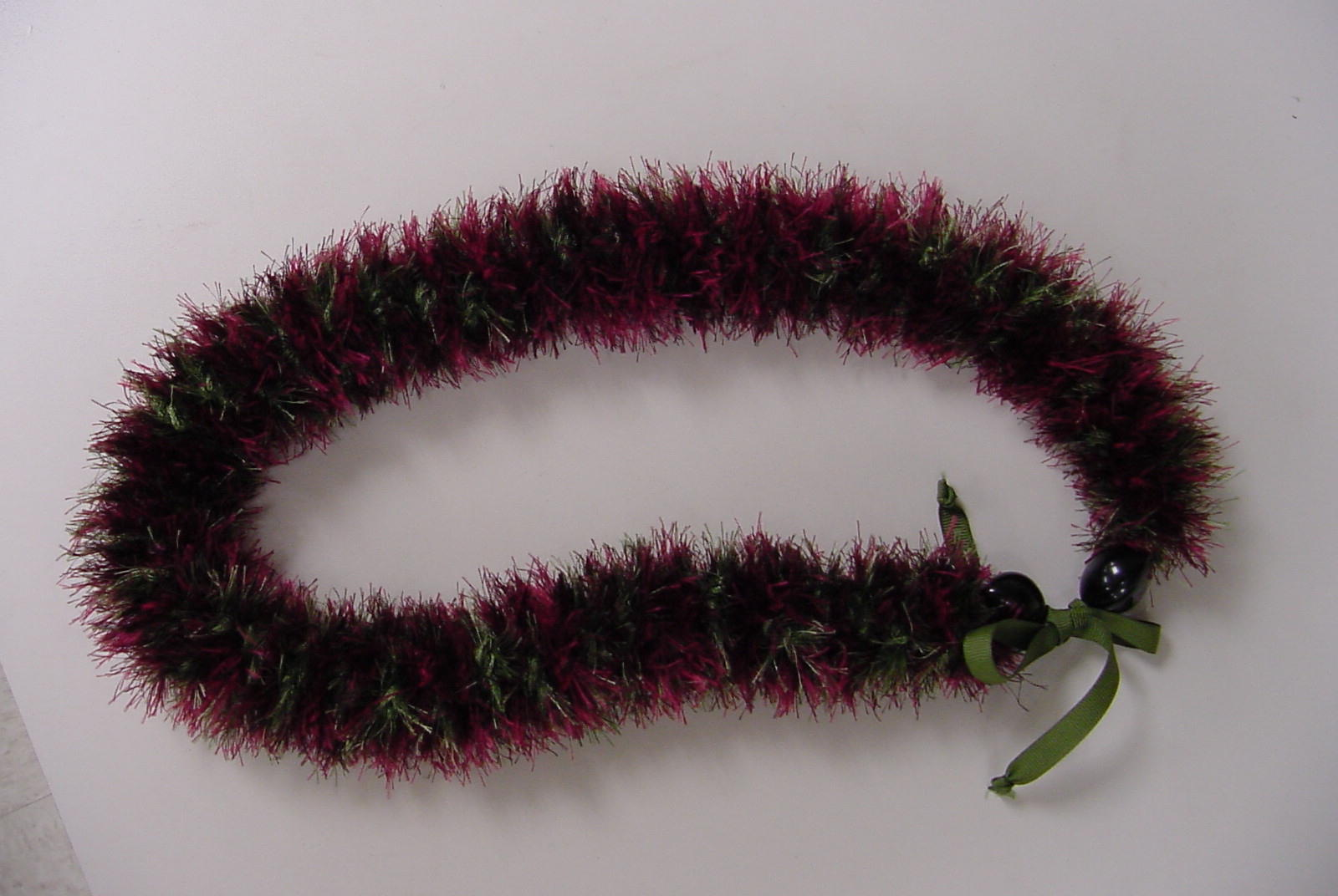 Sample of green/red eyelash lei
