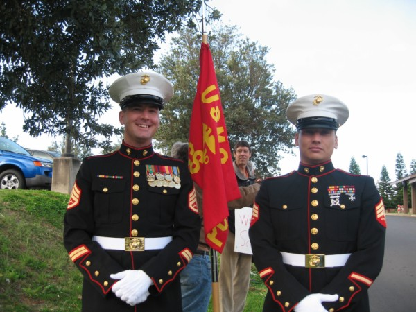Staff Sgt. York (Left)  with Maui raised, Sgt. Benz-Marrs (Right) at KKHS' Sign Waving event, Apr. 7, 2009
