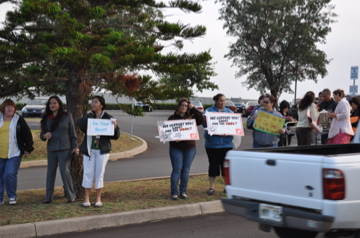 Sign Wavers represented County of Maui, Student Activities, Home Depot, Teachers at the Front Entrance